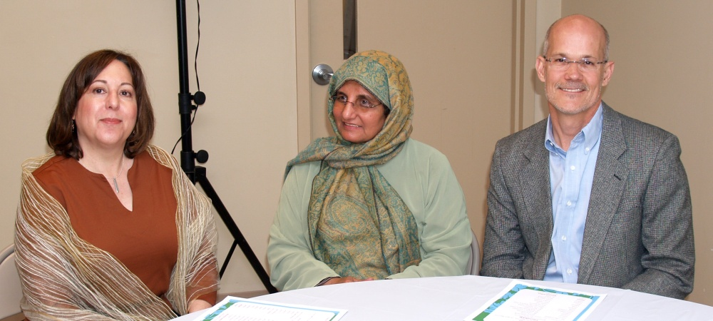 Ms. Lori Volpe (far left) with her husband and a member of the Pakistani community